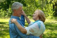 Elegant couple enjoy union with nature Royalty Free Stock Photos