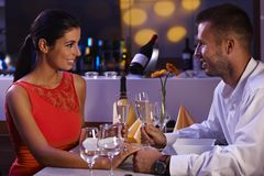 Elegant couple having dinner. Elegant loving couple having dinner in restaurant, smiling happy Royalty Free Stock Photo