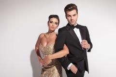 Elegant couple holding arms Royalty Free Stock Image