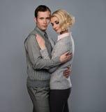 Elegant couple. Isolated on grey background Stock Photography