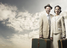 Elegant couple leaving with luggage Royalty Free Stock Photos