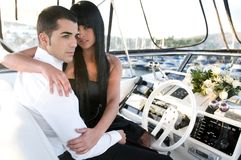Elegant couple loving in a yacht Stock Image