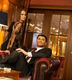 Elegant couple in luxury cabinet Stock Photography