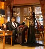Elegant couple in luxury cabinet. Elegant couple in formal dress in luxury cabinet interior stock photos