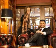 Elegant couple in luxury cabinet Stock Images