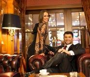 Elegant couple in luxury cabinet. Elegant couple in formal dress in luxury cabinet interior stock images