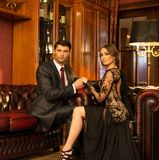 Elegant couple in luxury cabinet Royalty Free Stock Image
