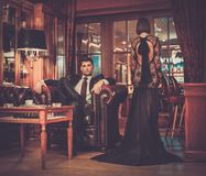 Elegant couple in luxury cabinet interior Stock Photography