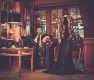 Elegant couple in luxury cabinet interior stock photography