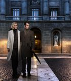 Elegant couple outdoors. Elegant couple in coats against building facade in evening Royalty Free Stock Image