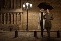 Elegant couple outdoors stock photography