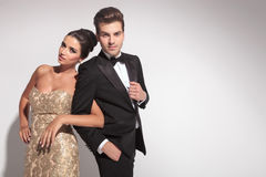 Elegant couple posing while holding arms Stock Photos