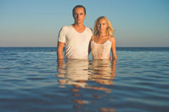 Elegant couple in the sea Royalty Free Stock Photos