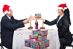 Elegant couple sharing Christmas gift Royalty Free Stock Images
