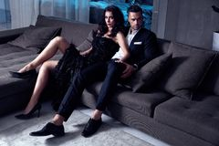 Elegant couple sitting on the couch Royalty Free Stock Photos