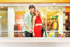 Elegant couple standing in the shopping mall Stock Images
