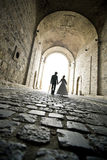An elegant couple walk in the tunnel Stock Photos