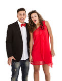 Elegant couple in white background silly faces Royalty Free Stock Photography