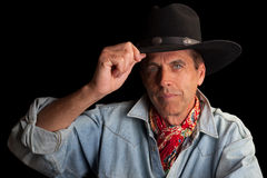 Elegant Cowboy. Gallant gentleman in a cowboy outfit tipping his hat stock photography
