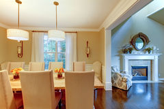 Elegant cream natural dining room with fireplace. Stock Photography