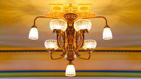 Elegant crystal chandelier. Ceiling mounted crystal chandelier in a room stock photos