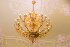 Elegant crystal chandelier.vintage pendant chandelier. Large crystal chandelier with pendants in ceiling. Luxurious royalty free stock photo