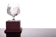 Elegant crystal cup trophy on white background flushed left. Elegant and classy crystal cup trophy on white background flushed left royalty free stock photos