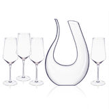 Elegant crystal decanter and wine glasses arranged on a white background. Royalty Free Stock Photos