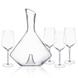 Elegant crystal decanter and wine glasses arranged on white surface. Royalty Free Stock Image