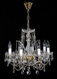Elegant crystal strass chandelier with eight lamps. Golden elegant crystal strass chandelier with eight lamps. Diamond strass chandelier on black background Stock Photo
