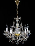 Elegant crystal strass chandelier with five lamps. Golden elegant crystal strass chandelier with five lamps. Diamond strass chandelier on black background Stock Photography