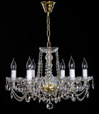 Elegant crystal strass chandelier with six lamps. Golden elegant crystal strass chandelier with six lamps. Diamond strass chandelier on black background Royalty Free Stock Photo