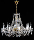 Elegant crystal strass chandelier with ten lamps. Golden elegant crystal strass chandelier with ten lamps. Diamond strass chandelier on black background Stock Photos