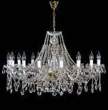 Elegant crystal strass chandelier with ten lamps. Golden elegant crystal strass chandelier with sixteen lamps. Diamond strass chandelier on black background Stock Images