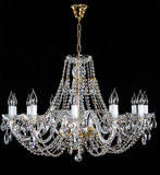 Elegant crystal strass chandelier with ten lamps. Golden elegant crystal strass chandelier with twelwe lamps. Diamond strass chandelier on black background Royalty Free Stock Images