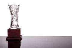 Elegant crystal vase trophy on white background flushed left. Elegant and classy crystal vase trophy on white background flushed left royalty free stock photo