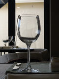 Elegant crystal wineglass on restaurant table Royalty Free Stock Photography
