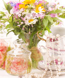 Elegant cups and flowers Stock Photo