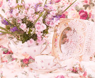 Elegant cups, flowers and retro frame Royalty Free Stock Photo