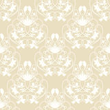 Elegant damask beige seamless vector background. With delicate white swirl design Royalty Free Stock Photography