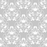 Elegant damask grey seamless vector background. With white delicate swirl design Stock Image