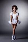 Elegant dark-haired gymnast posing in studio Royalty Free Stock Image