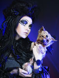 Elegant dark queen with little dog Royalty Free Stock Photography