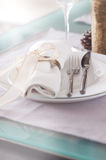 Elegant decorated Christmas table setting with modern cutlery, napkin, bow and christmas decorations Royalty Free Stock Image
