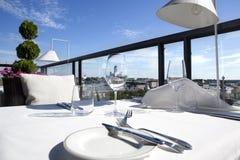 Elegant design restaurant terrace. Helsinki. Fancy terrace of a modern design restaurant with table ready in Helsinki. Detail of the lutheran landmark cathedral Stock Photos