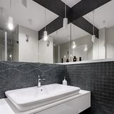 Elegant designed black and white bathroom. With decorative ceiling and stylish lamps stock photo