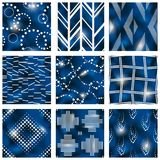Set of blue batik patterns. 9 elegant detailed blue and beige seamless patterns made to look like batik fabric prints. Graphics are grouped and in several layers Royalty Free Stock Image