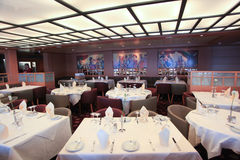 An elegant dining hall in cruise ship Royalty Free Stock Photography