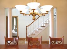 Elegant dining room. With columned partition to foyer with staircase Royalty Free Stock Photography