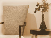 Elegant Dining Room Chair with Side Table and Vase of Flowers Royalty Free Stock Photography
